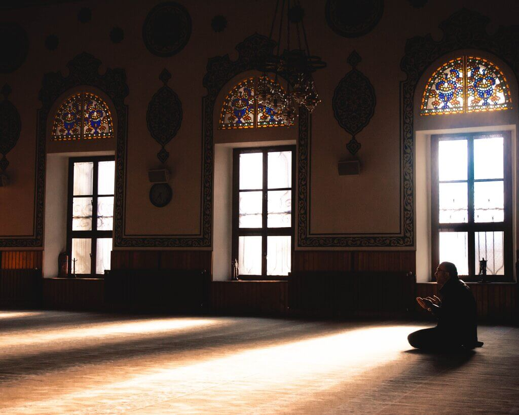 Image of person reading Surah Talaq Ayat